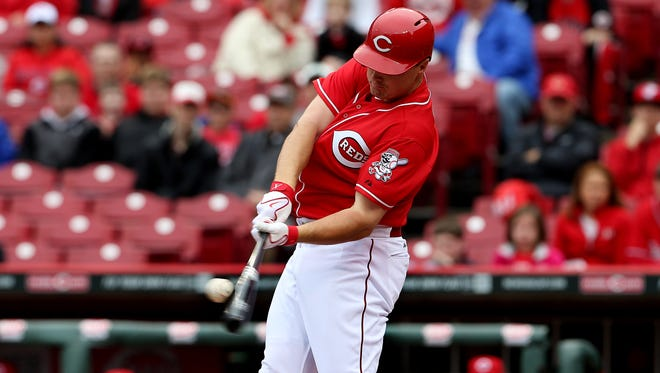 Reds right fielder Jay Bruce hits a two-run homer against St. Louis on April 3.