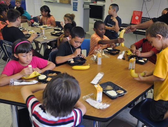 Southeast Boys and Girls Club members sit down for
