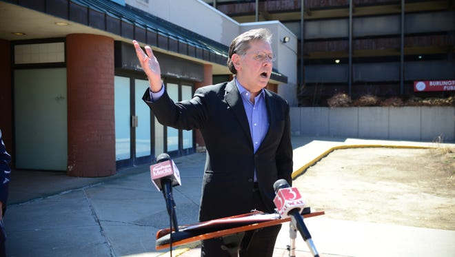 Burlington Town Center owner Don Sinex praises a proposed development agreement with the city at an April 20 news conference.