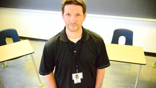 Burlington High School teacher Michael Havens may be laid off in the latest round of budget cuts.