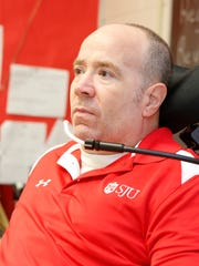 Paralyzed teacher Billy Keenan is back at work at North