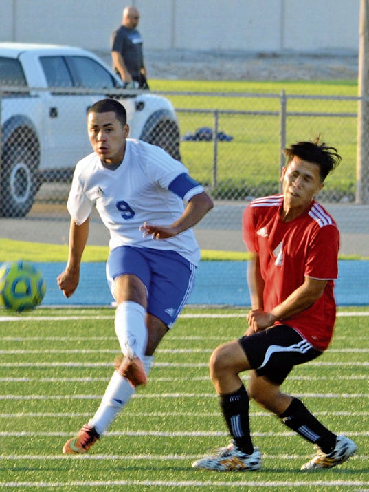 Matt Hollinshead — Current-Argus Cavemen senior forward Jesus Estrada passes the ball down to the field for an assist to senior midfielder Andrew Quintela late in the first half Tuesday. Estrada later scored Carlsbad's second goal in the second half.