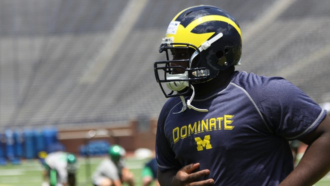 Michael Onwenu is the biggest Michigan player at 375 pounds.