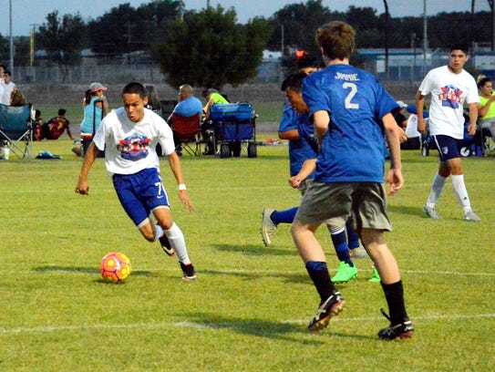 Robert Madrid of Roswell Galaxy FC looks to pass the