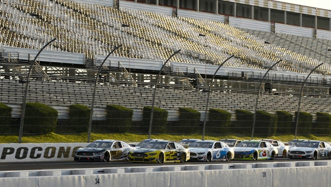 The field lines up for a restart during the NASCAR Cup Series auto race at Pocono Raceway, Sunday, June 28, 2020, in Long Pond, Pa.