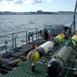 Two REMUS 600's autonomous undersea vehicles head to sea aboard the TWR 841 during AUVfest 2008, currently being held at the Naval Undersea Warfare Center's Narragansett Bay Test. AUVfest is a demonstration of 13 AUV systems originally developed by the Office of Naval Research for mine hunting.