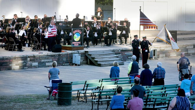 Lee Wenger sings the national anthem during the opening night of the Peoria Municipal Band's season on Sunday, June 3, 2018 at the Glen Oak Park Amphitheatre in Peoria.