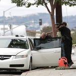 Police investigate a car in Santa Monica, Calif.