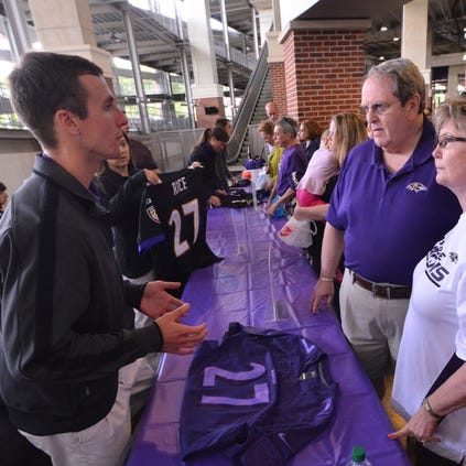 Sep 19, 2014; Baltimore, MD, USA; Baltimore Ravens fans speak with a uniform authenticator during the Ray Rice  jersey exchange at M&T Bank Stadium. Mandatory Credit: Tommy Gilligan-USA TODAY Sports