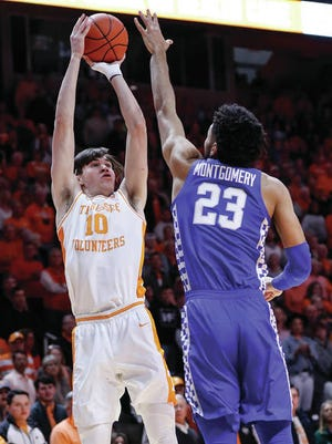 John Fulkerson (10) shoots over Kentucky's E.J. Montgomery, as the visiting 15th-ranked Wildcats snapped a four-game losing streak at Thompson-Boling Arena with a 77-64 win Saturday over host Tennessee.