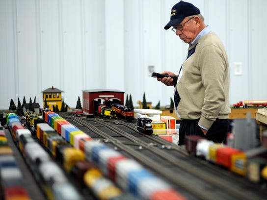 In this file photo, Mike Conard of De Pere works on