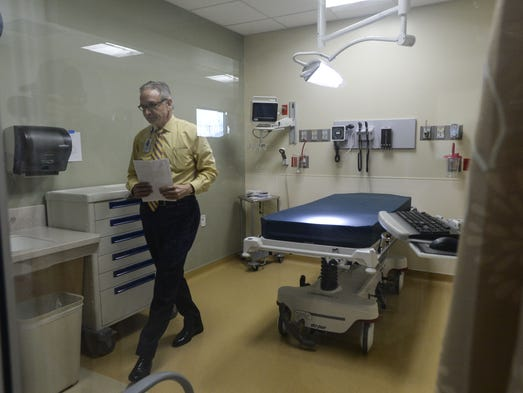 John D'Angelo, chief operating officer, shows an exam