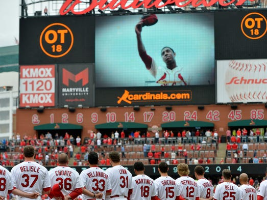 Cardinals teammates watch a tribute video to memorialize