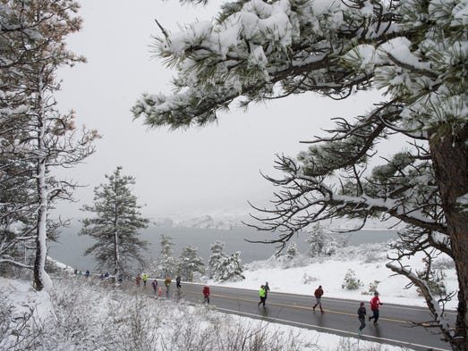 Fresh snow lines the course as runners compete in the