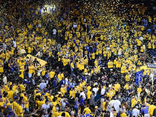 Confetti falls as spectators celebrate the Golden State