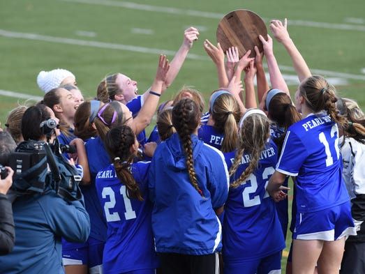 The Pearl River girls soccer team celebrates after