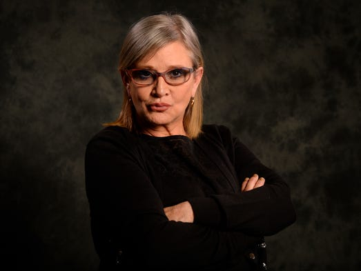Carrie Fisher, photographed in December 2015, has died