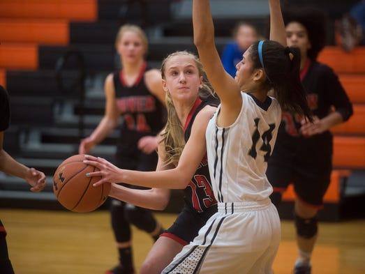 Dover's Ashley Goebeler looks to shoot the ball against