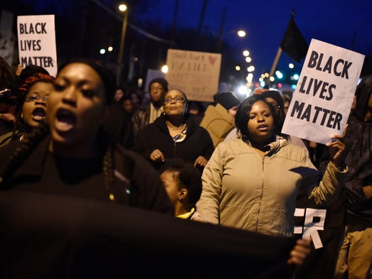 Residents march down Shelby Avenue on Tuesday, Feb.