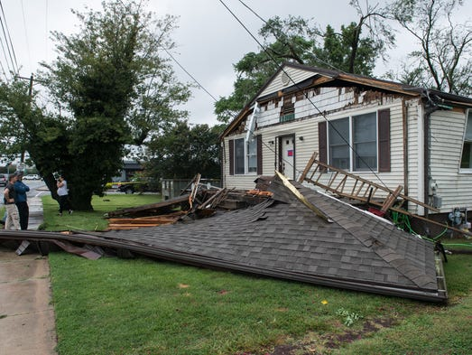 A view of a damaged home on College Avenue after a