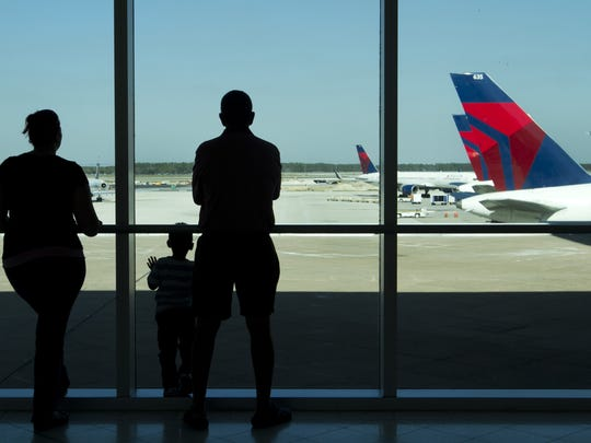 Brandy Elam, her son Brayden, 3, and her father Joe Elam of Bonita Springs wait for the arrival of Brayden's grandmother from Canada on Thursay at Southwest Florida International Airport in south Fort Myers.