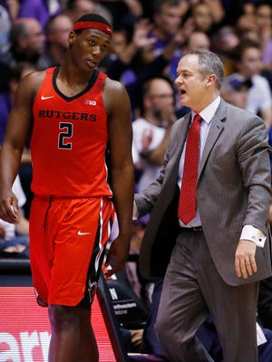 Rutgers head coach Steve Pikiell, right, talks with center Shaquille Doorson during the second half of a game against Northwestern Saturday, Feb. 18, 2017, in Evanston, Ill. Northwestern won 69-65.