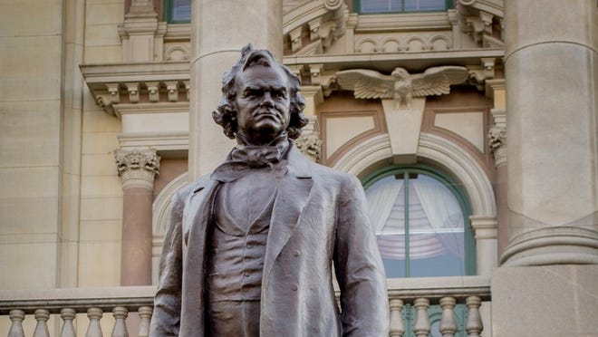 A statue of slave owner Stephen Douglas sits directly behind one of his political rival -- Abraham Lincoln -- at the Illinois Statehouse. The board of the Office of the Architect of the Capitol decided Wednesday to remove the statue from the Capitol grounds.