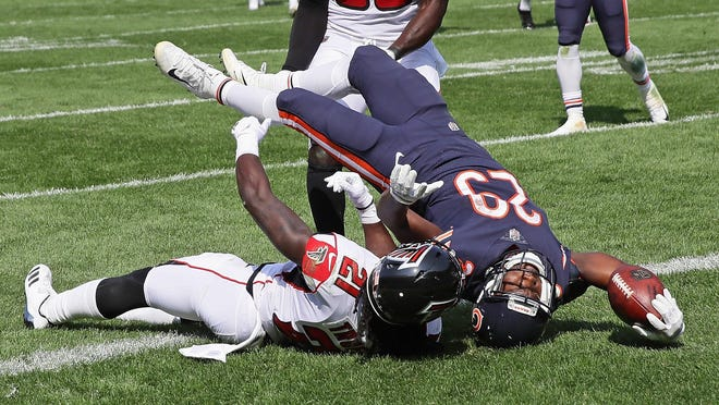Chicago Bears rookie Tarik Cohen falls over Desmond Trufant to score his first NFL touchdown. Cohen was a popular target for Mike Glennon, catching eight passes.