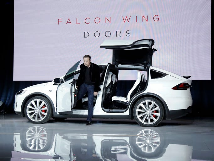 Tesla Unveils New Model X Crossover Suv