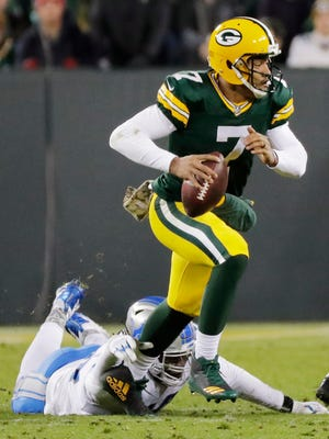 Green Bay Packers quarterback Brett Hundley (7) scrambles away from pressure in the second quarter against the Detroit Lions at Lambeau Field on Monday, November 6, 2017 in Green Bay, Wis.