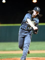 Hendersonville High senior pitcher Will Wacaser delivers a fourth-inning pitch. Wacaser picked up the complete-game victory on Tuesday evening, scattering nine hits while striking out 13 hitters.