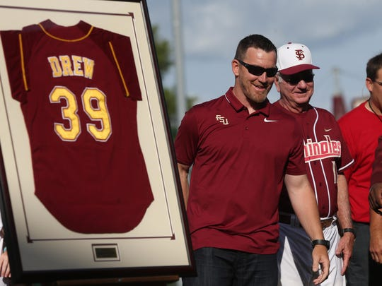 J.D. Drew stands with Florida State head coach Mike Martin as his jersey is retired at Dick Howser Stadium in April 2017.