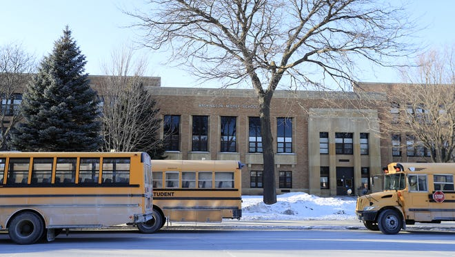 School buses are lined up at the end of the school day at Washington Middle School.