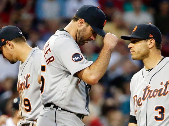 Tigers pitcher Justin Verlander, center, stands on the mound after a conference with teammates, including Nicholas Castellanos (9) and Ian Kinsler (3), during the third inning Saturday in Boston.