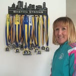 Kathy Waldron of Allouez will be running her 25th consecutive Boston Marathon on April 18. Waldron is pictured on the Fox River Trail where she frequently trains April 12,  2016.