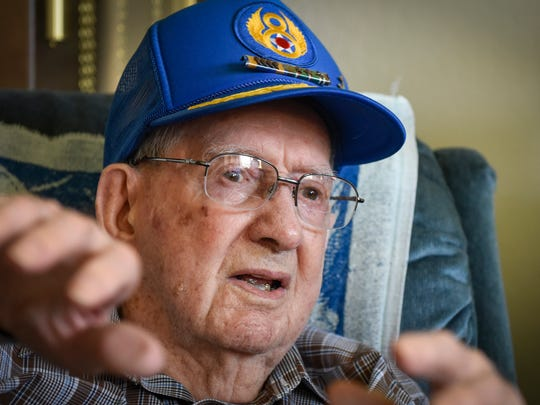 Don Fish, 100, tells stories about being a co-pilot of a B-17 bomber flying missions over Germany Thursday, Oct. 19, at Country Manor in Sartell.