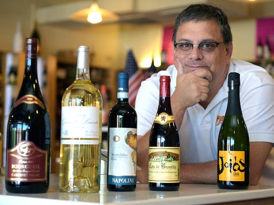 Village Wines owner Ed Fryer says offering speciality wines with reasonable prices will help his business compete with grocery stores.