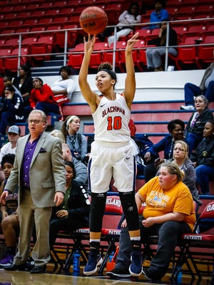 Blackman's Jaida Bond fires a 3-pointer during Thursday's 79-23 win over Smyrna in the 7-AAA quarterfinals.