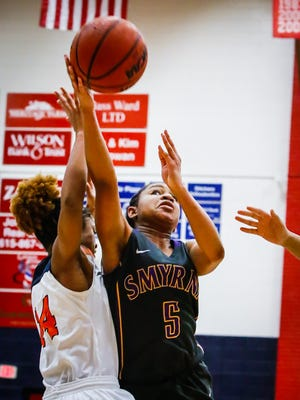Smyrna's Saniyh Stafford goes up for a shot as Blackman's Joelle Patton defends during the Lady Blaze's 79-23 win Thursday.