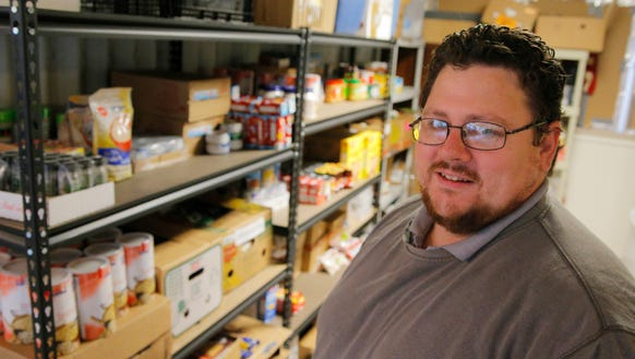 Jon Ezell runs the St. Paul's food pantry with his