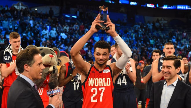 World Team guard Jamal Murray of the Denver Nuggets celebrates winning the MVP during the Rising Stars Challenge at Smoothie King Center.
