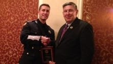Deputy Johnathon Cihanek, left, with Putnam Sheriff Donald Smith after Cihanek  was honored by the Southern Dutchess Exchange Club for saving a suicidal woman in Putnam Valley Dec. 18, 2013.