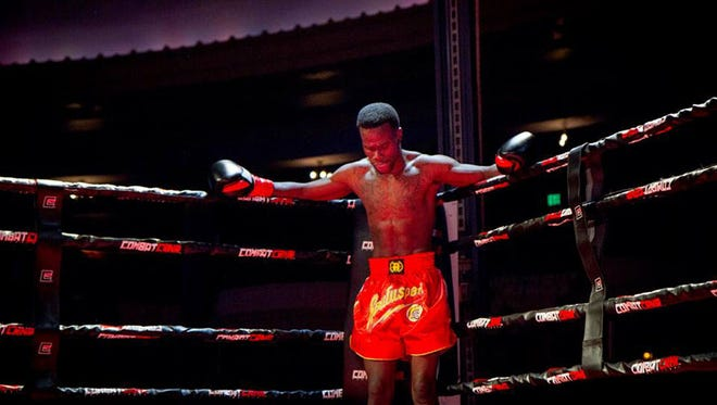 Dennis Munson Jr. during the second round of his first kickboxing match March 28, 2014. Munson collapsed after the fight and died later that night. Dennis Munson Jr. stands in his corner during the second round of his first kickboxing match March 28, 2014 in Milwaukee. Munson collapsed in the ring after the fight and died of injuries sustained in the match later that night. Photograph by Marissa Biese DO NOT INCLUDE A BYLINE FOR THE PHOTOGRAPHER ON THIS IMAGE. ORG XMIT: MJS1410171537171012