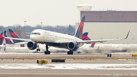 A Delta Air Lines Boeing 757-200 takes off from Minneapolis