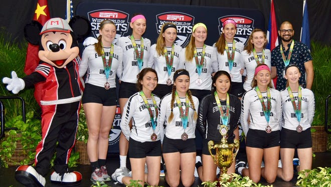 The Evansville United (U16 black) volleyball team poses with their bronze medalists at the AAU Girls' Junior National Volleyball Championships.