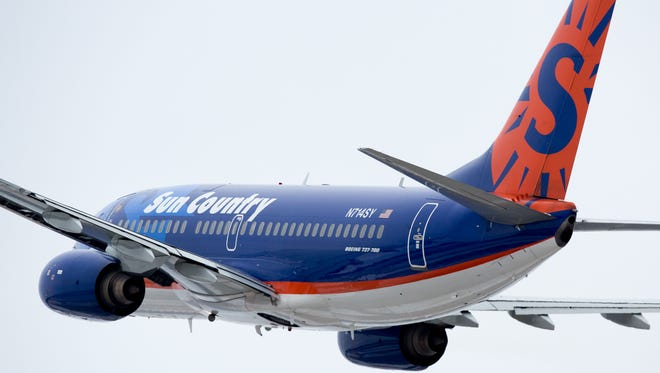 A Sun Country Boeing 737 takes off from Minneapolis/St. Paul International Airport in January 2017.