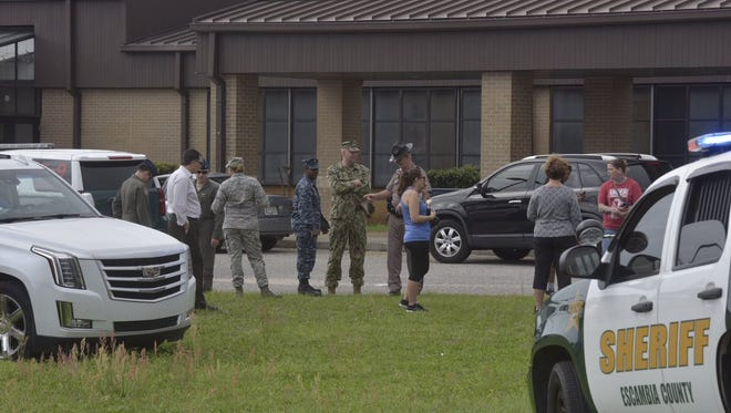 Worried parents of Bailey Middle School gather outside the school while under lockdown Wednesday.
