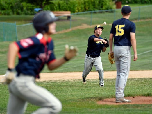Gettysburg's Kyle Redding throws to first base to force