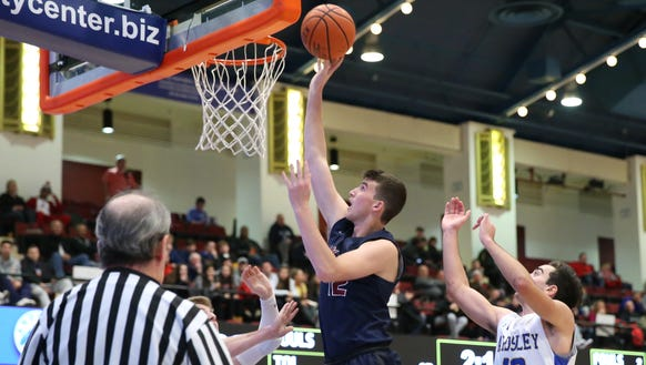 Byram Hills' Ben Leff (12) puts up a shot as Ardsley's Vincent Manzi (13) defends during the Crusader Classic at the Westchester County Center in White Plains on Friday, January 5, 2018.