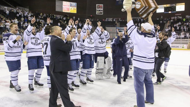 Ice Flyers owner Greg Harris holds up the 2016 SPHL President's Cup during the team's celebration, after beating the Peoria Rivermen 5-4 in the clinching game.  It was the Ice Flyers' third championship in four years.